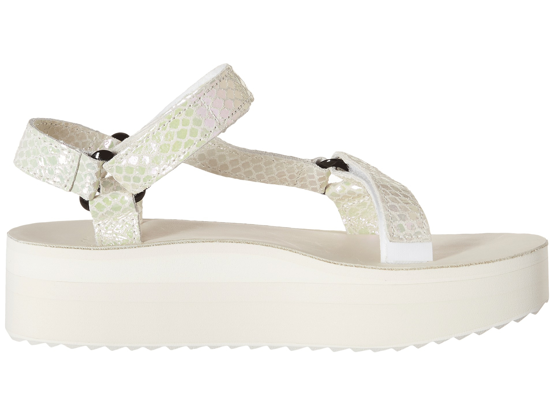 ace61a0dacf Lyst - Teva Flatform Universal Iridescent in White