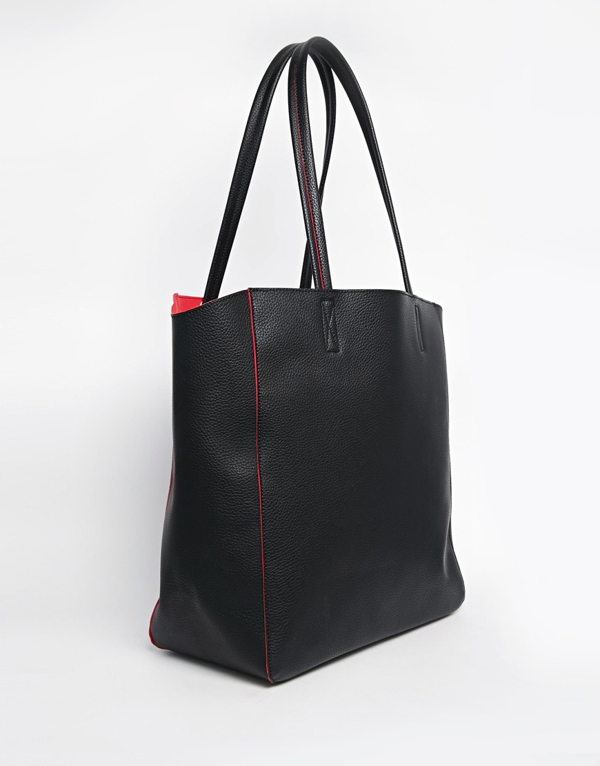 asos winged shopper bag in black lyst