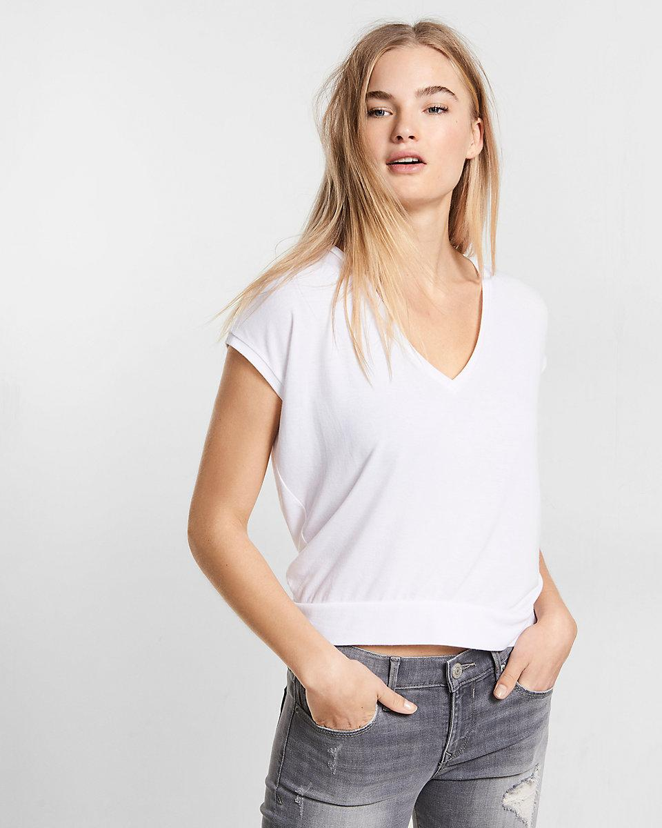 Lyst express banded bottom dolman tee in white for Banded bottom shirts canada