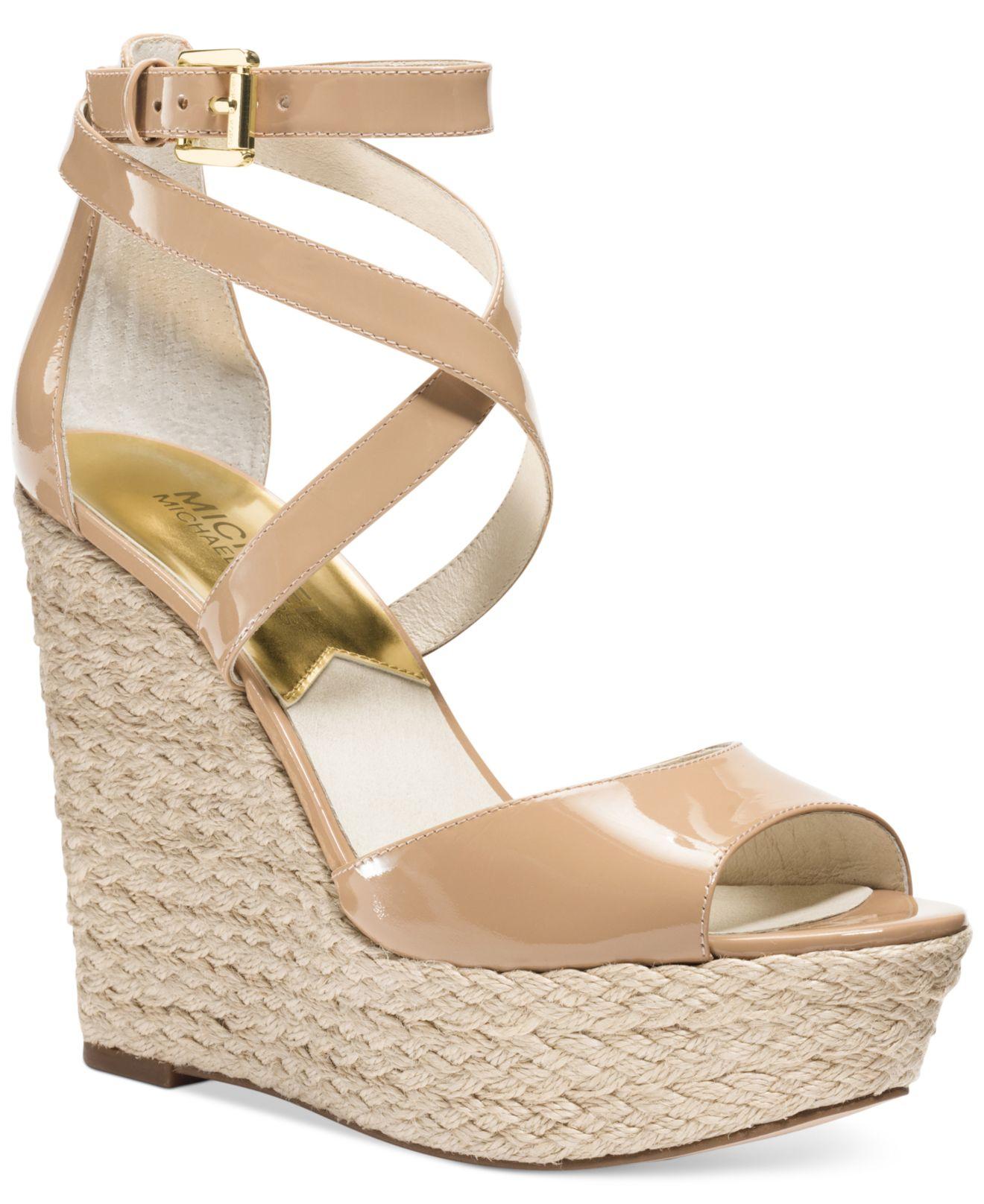 4ac3ccc70b4 Lyst - Michael Kors Michael Gabriella Platform Wedge Sandals in Natural