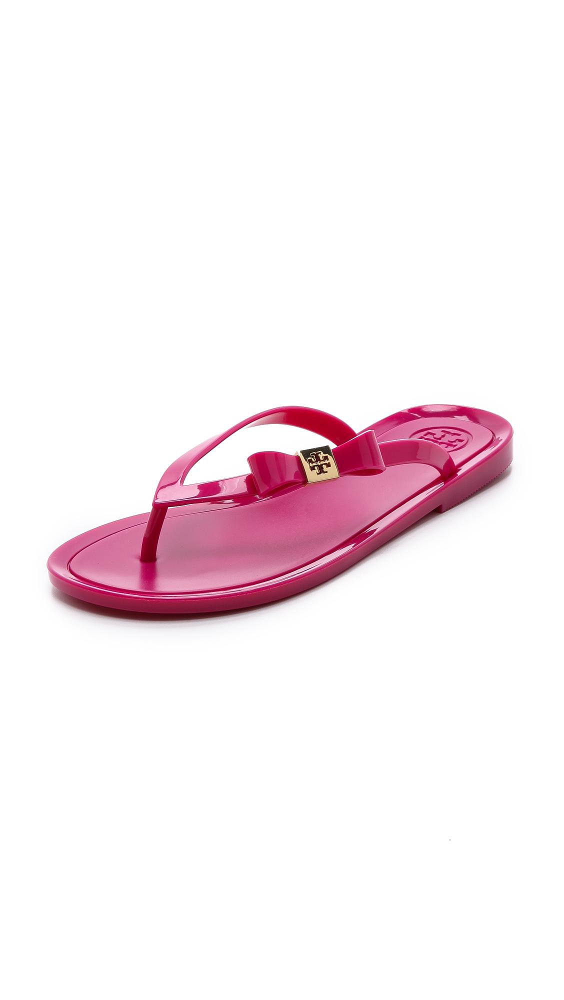 59c574a06733 Lyst - Tory Burch Michaela Bow Jelly Flip Flops - Dark Fuchsia in Pink