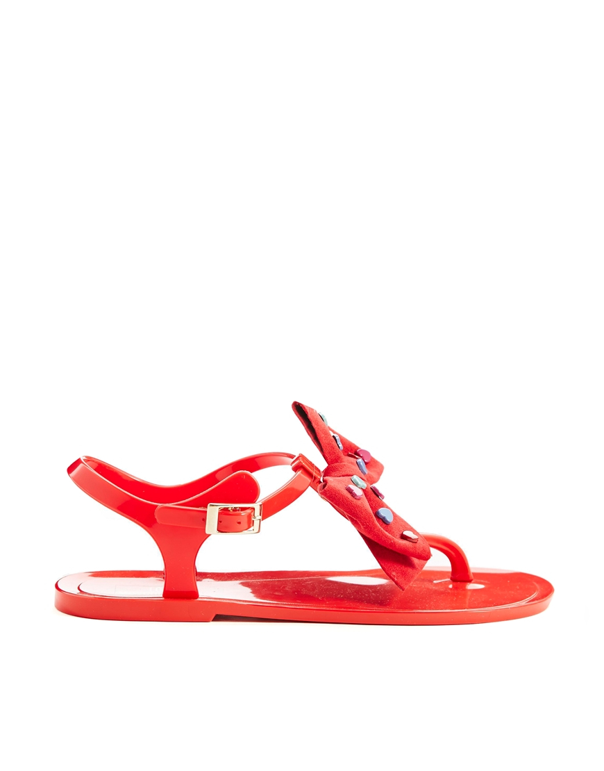 0c462c102e7d Lyst - Love Moschino Heart Bow Red Jelly Flat Sandals in Red