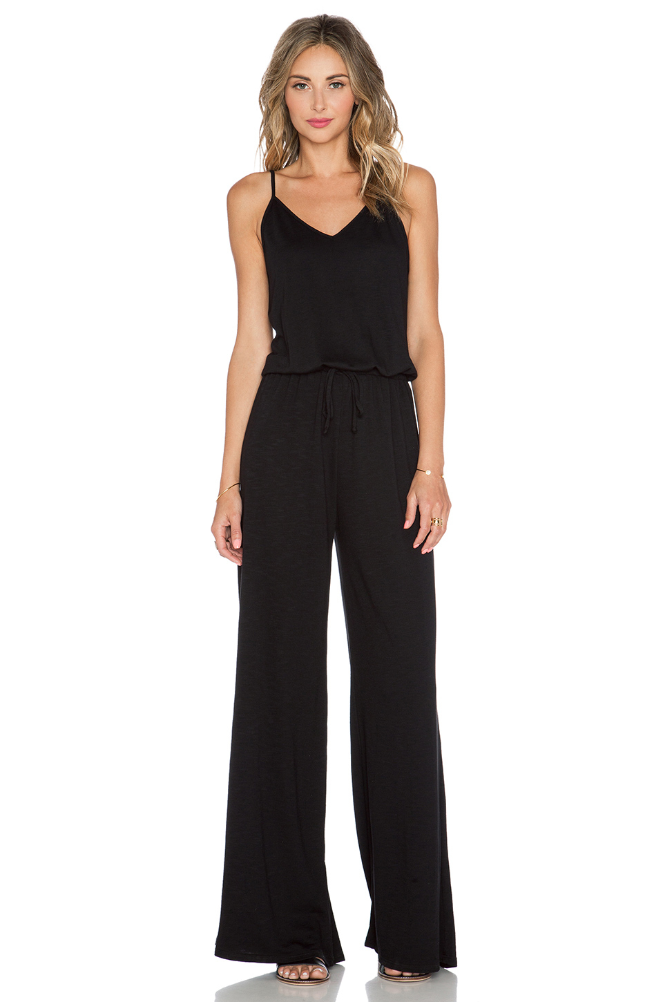 Jump start your new season wardrobe with the always chic and versatile jumpsuit. This 70s inspired one piece is an ultra-versatile day-to-night wonder. Dress up with stiletto heels and a clutch bag, or go casual and rock with sliders and a faux leather jacket for on-trend transitional dressing.