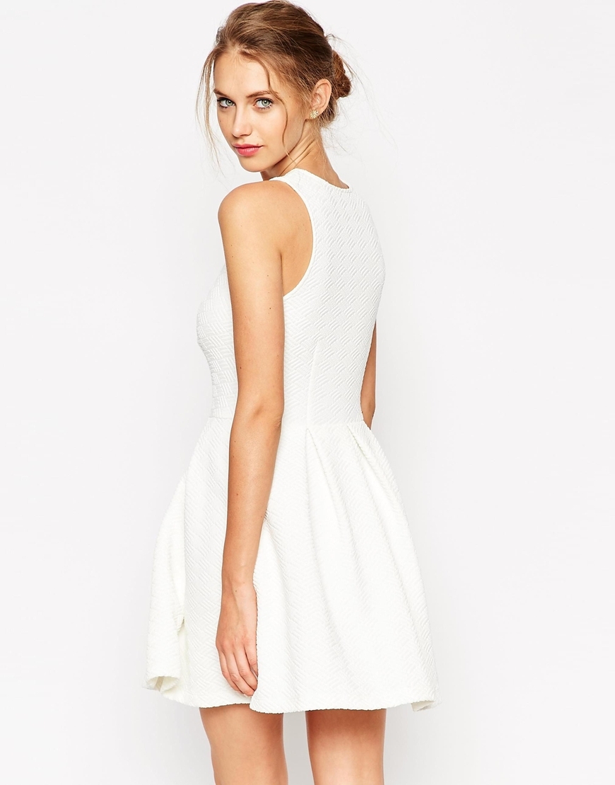 73ba9a092f Lyst - ASOS Textured Skater Dress With Bib Lace Detail in White