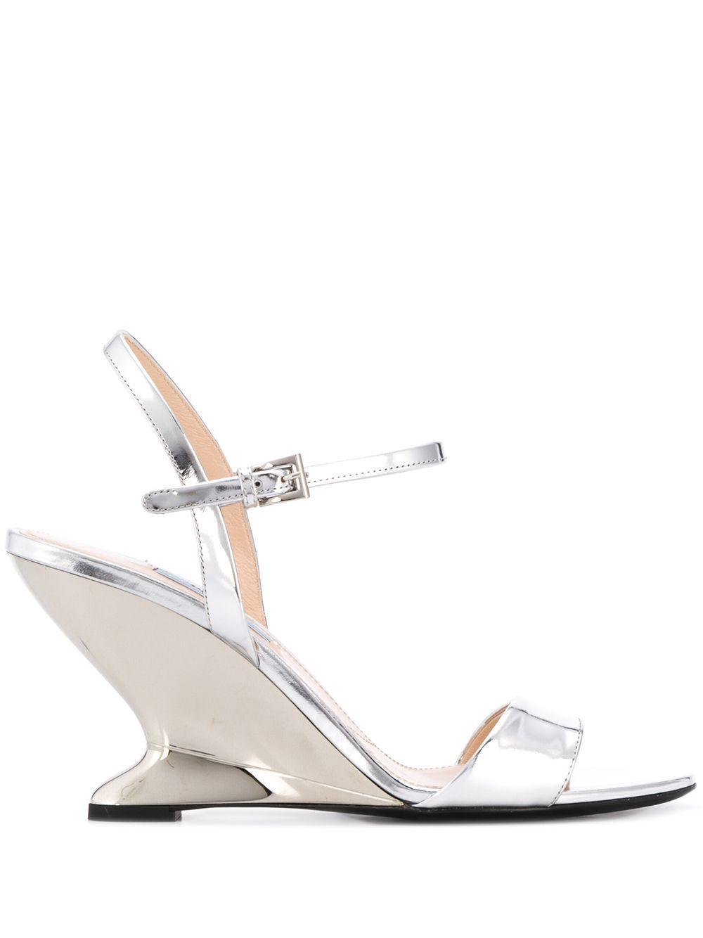 a961279a6e0 Lyst - Prada Structured Wedge Sandals in Metallic