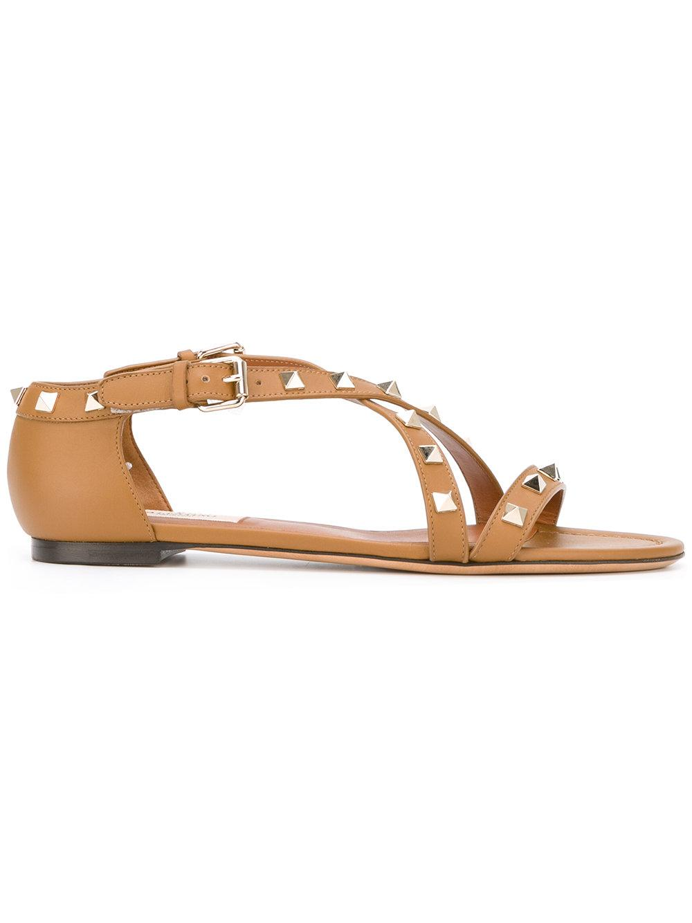 Lyst Valentino Garavani Rockstud Flat Sandals In Brown