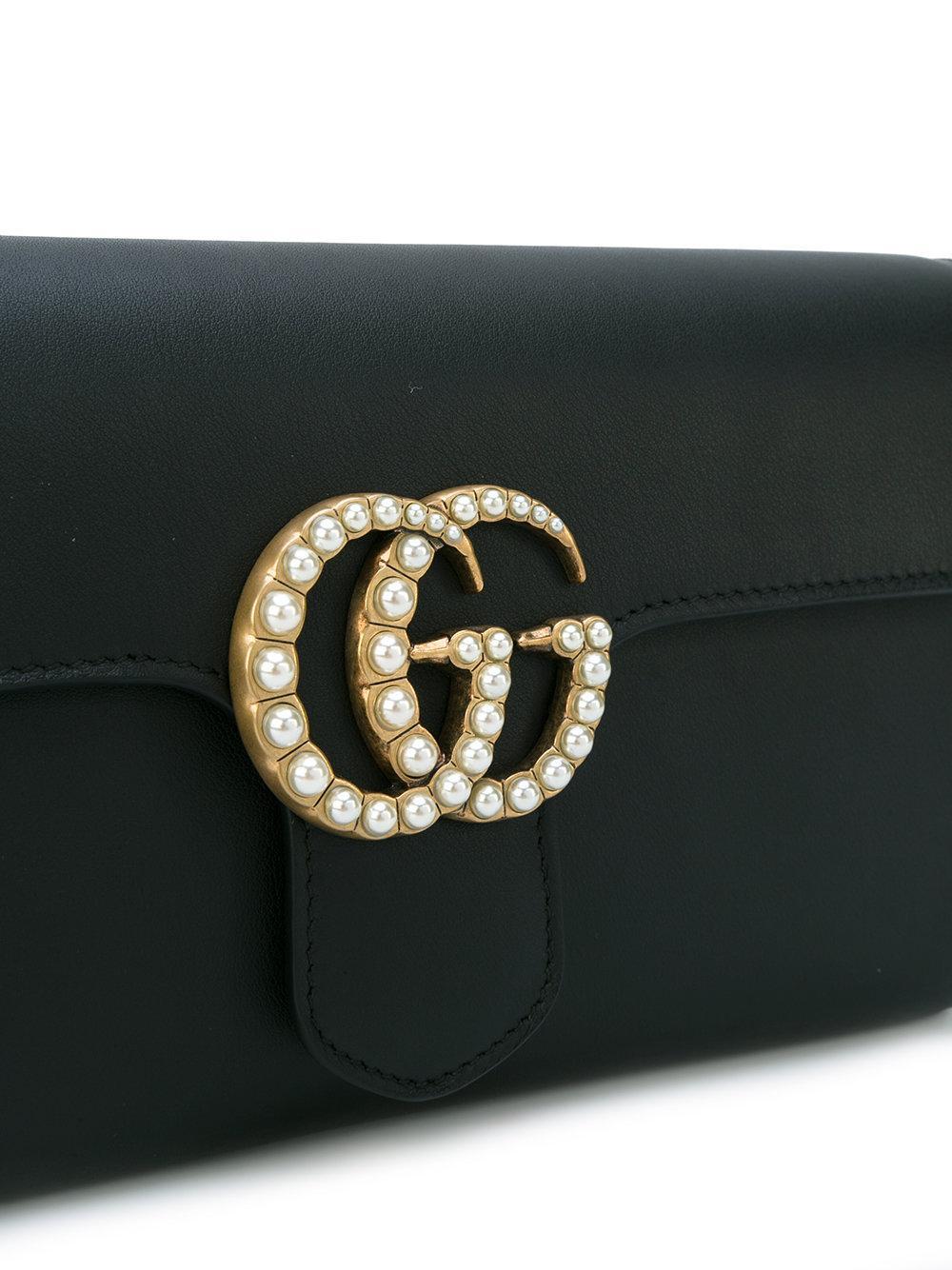 Gucci Leather Gg Logo Clutch Bag In Black Lyst