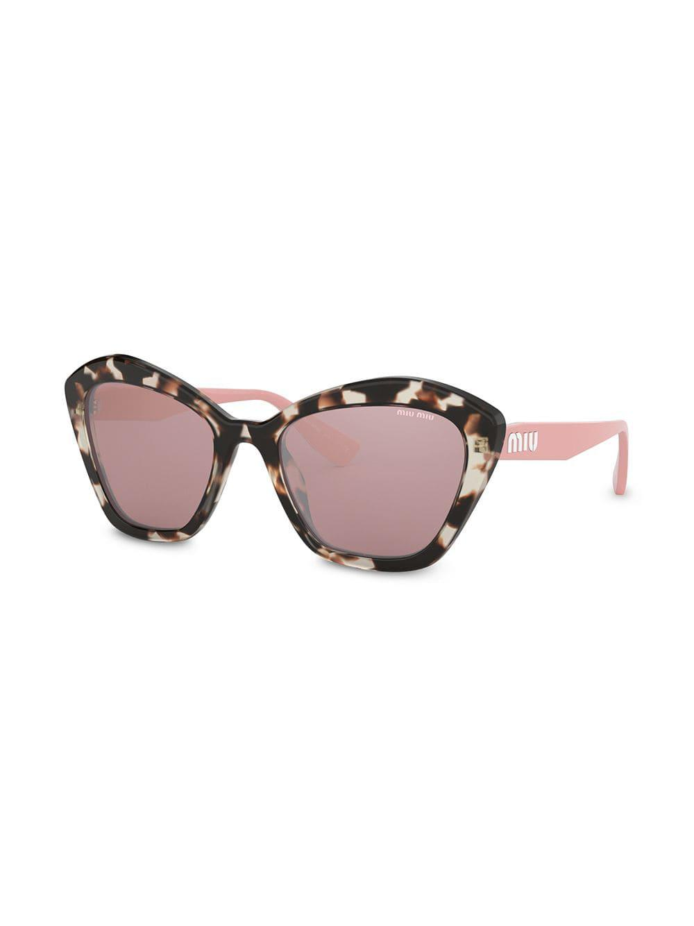 e518baa766f Miu Miu Oversized Cat-eye Sunglasses in Brown - Lyst
