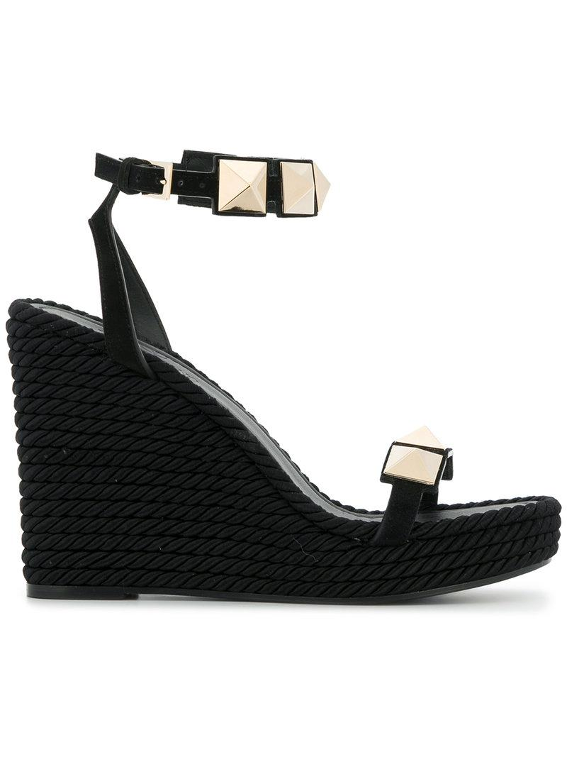 bb51ed131e93 Lyst - Valentino Wedge Stud Sandals in Black