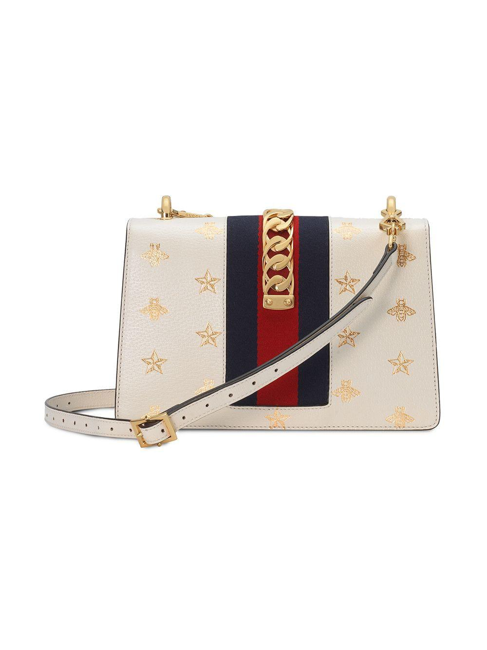 86bc778d78c40a Gucci Sylvie Bee Star Small Shoulder Bag in White - Lyst