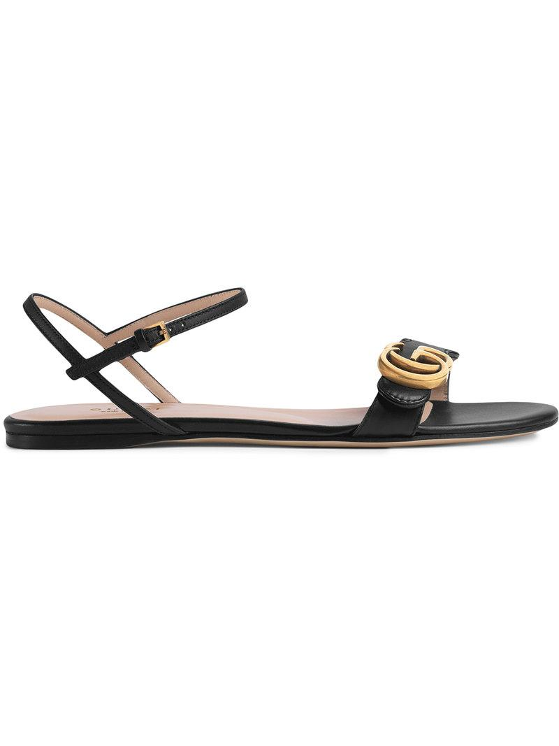8df42e834bcd87 Lyst - Gucci Leather Double G Sandal in Black - Save 17%