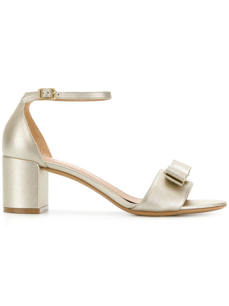 9b06af8ed6ff Lyst - Ferragamo Vara Bow Sandals in Metallic