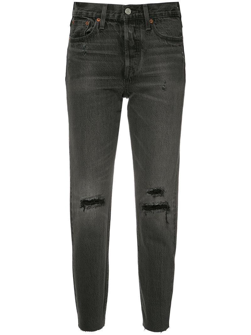Lyst Levi S High Rise Ripped Cropped Jeans In Black