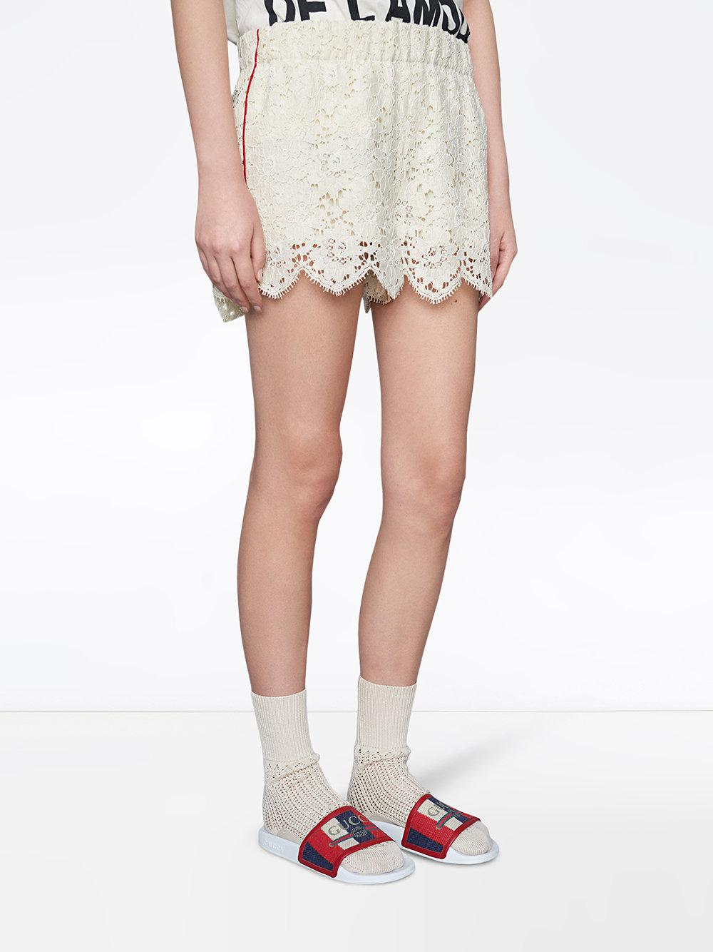 f29241447 Lyst - Gucci Logo Sylvie Slide Sandals in White
