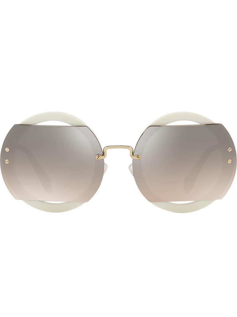 d4eabd709fc Miu Miu. Women s Circle Sunglasses