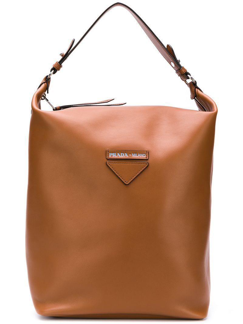 5f9cb96bcebe Lyst - Prada Logo Tote Bag in Brown