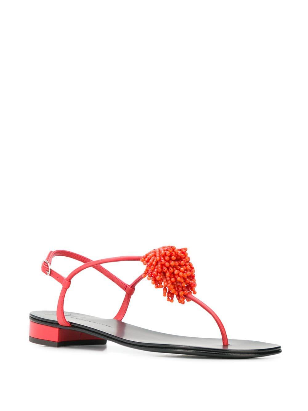 f82988fd7f05 Lyst - Giuseppe Zanotti Flat Flower Sandals in Red
