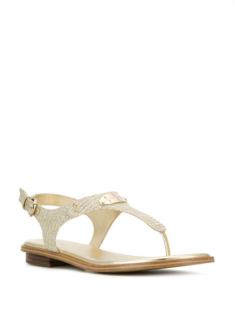 ec1ccdcd3cdb Lyst - MICHAEL Michael Kors Mk Plate Embellished Sandals in Metallic