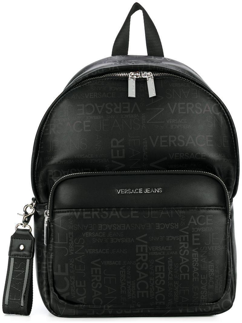 e886b2ef94c9 Lyst - Versace Jeans Backpack In Black In Repeat Logo Print in Black ...