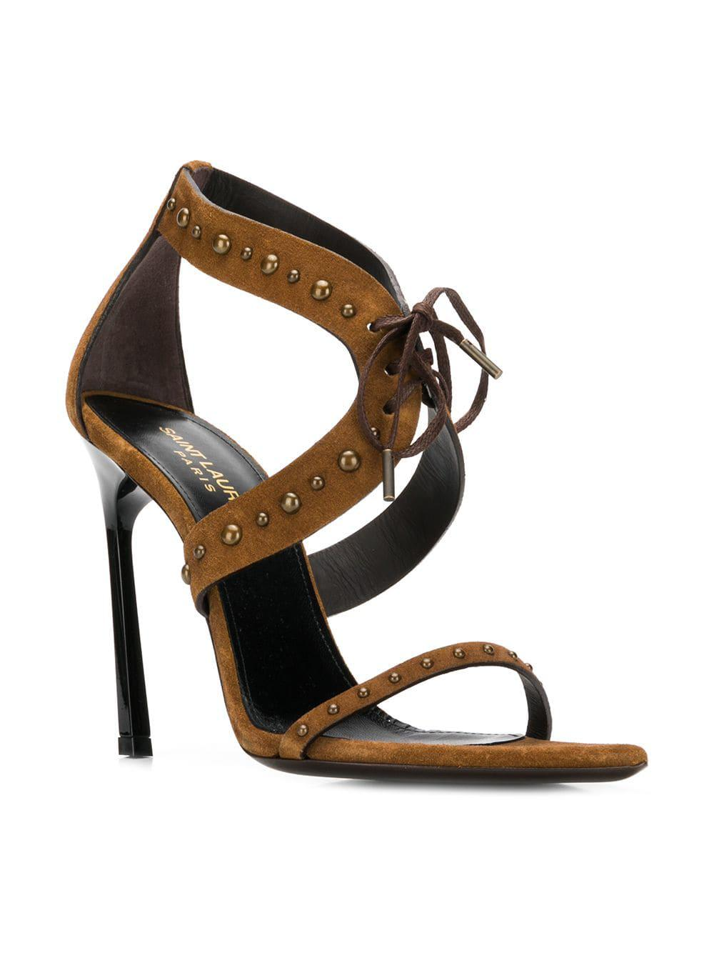 d5deb1e2a80 Lyst - Saint Laurent Studded Sandals in Brown