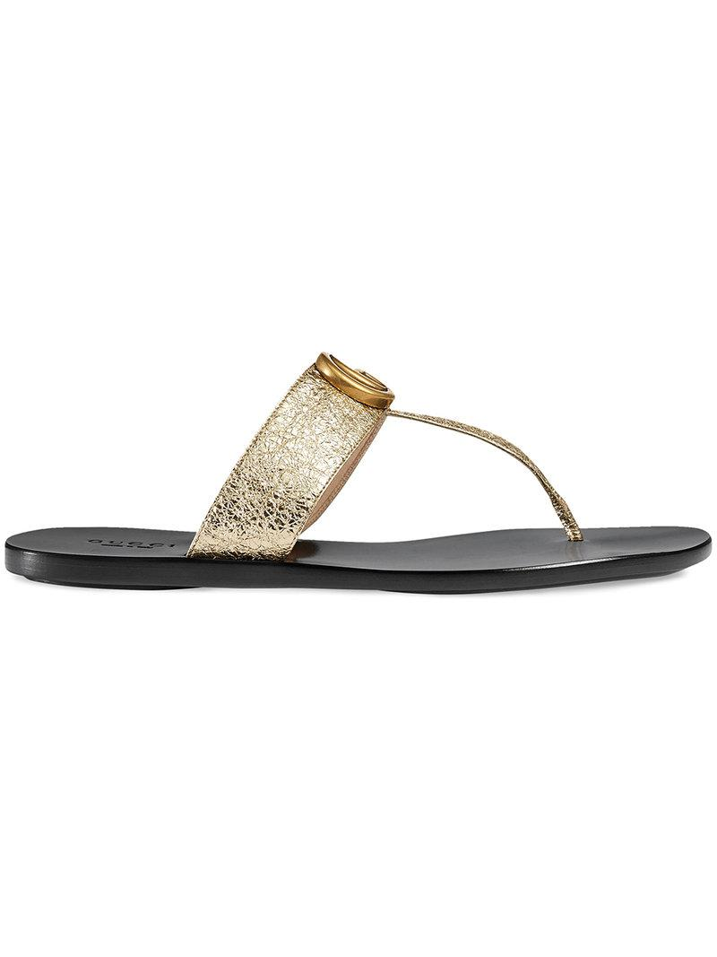 e89437f3c04 Gucci Leather Thong Sandal With Double G in Metallic - Lyst