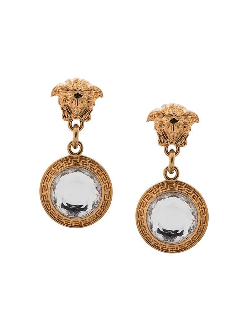 00782cdda Versace Medusa Head Earrings in Metallic - Lyst