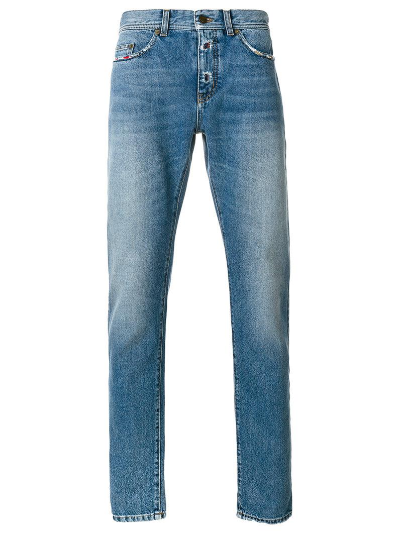 df94aa661b9 Lyst - Saint Laurent Low Rise Distressed Trim Jeans in Blue for Men ...