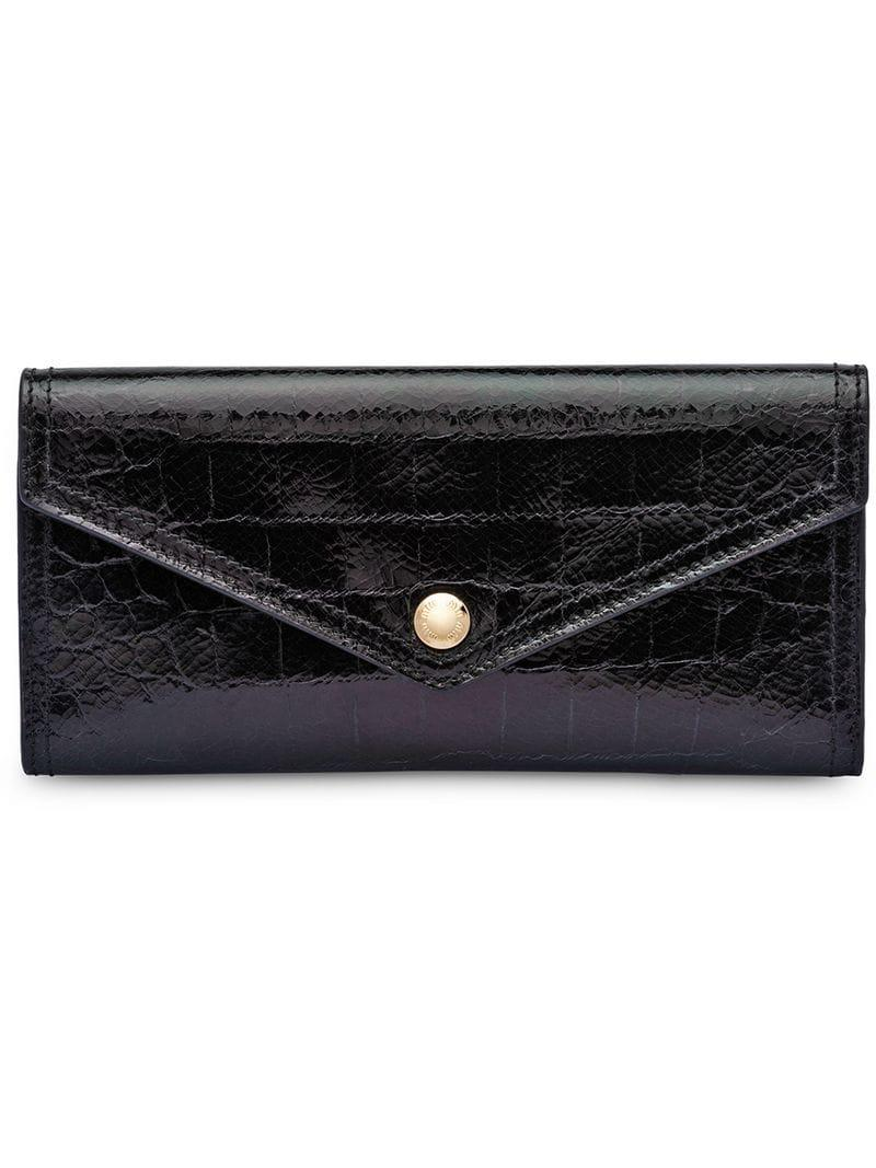 5950e8954670 Lyst - Miu Miu Madras Wallet in Black