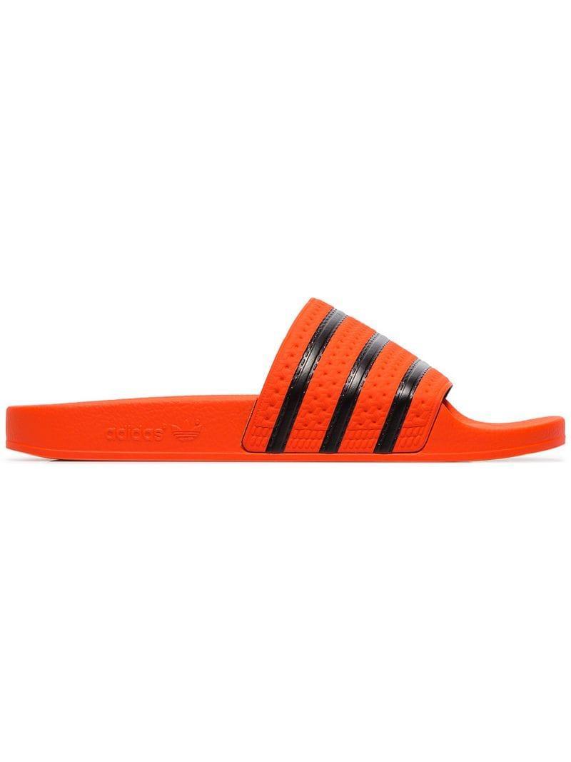 Lyst - adidas Orange Adilette Rubber Slides for Men 1927cf7d0