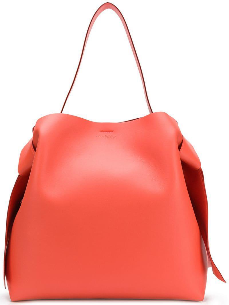 bc53ec7ba3 Acne Studios. Grand sac porté épaule Musubi femme de coloris orange