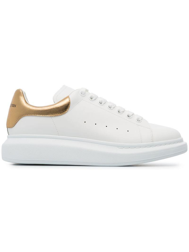 407c8cba79ed6 Alexander McQueen. Men s White Gold Foil Embellished Chunky Leather Sneakers