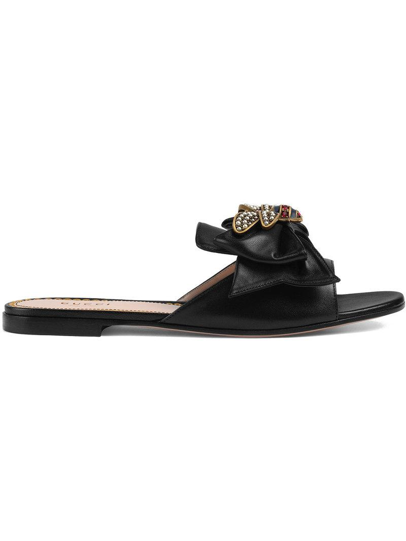 922813af472 Lyst - Gucci Leather Slides With Bow in Black