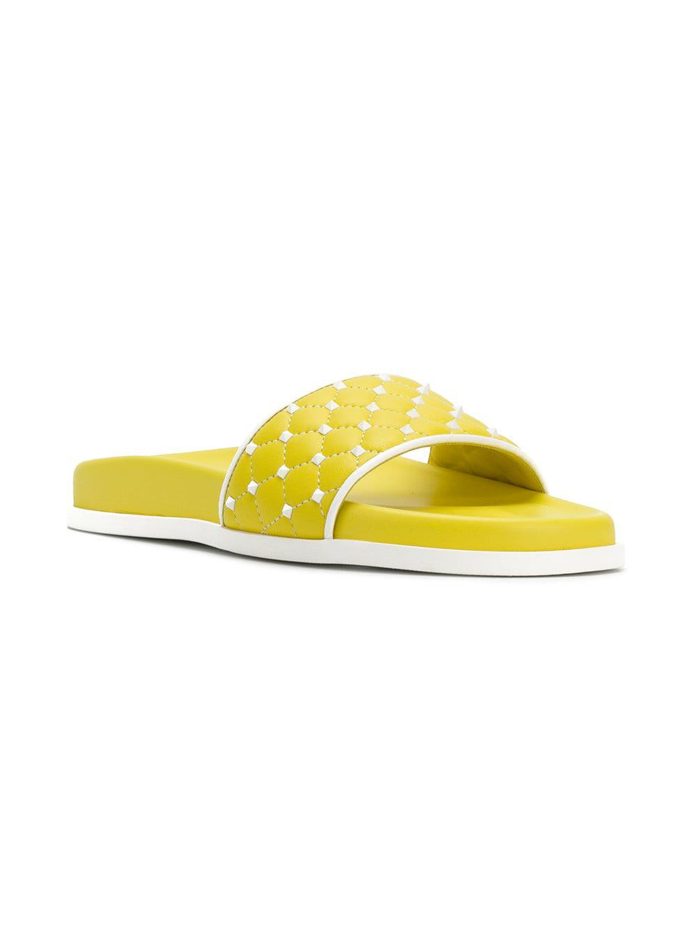e6bafde614eb Valentino - Yellow Garavani Free Rockstud Spike Slides - Lyst. View  fullscreen