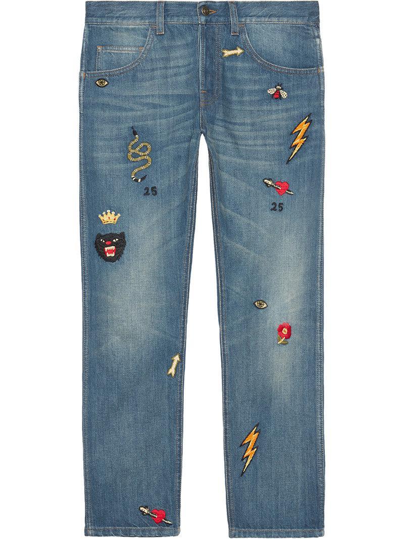 f8e1266b6b4 Lyst - Pantalon en jean fuselé avec symboles Gucci pour homme en ...