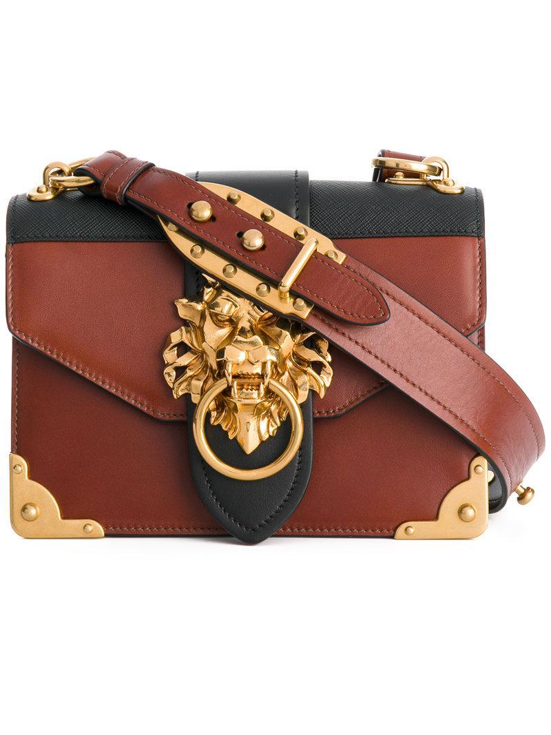 03c025494d76 Prada Cahier Lion-embellished Shoulder Bag in Brown - Lyst
