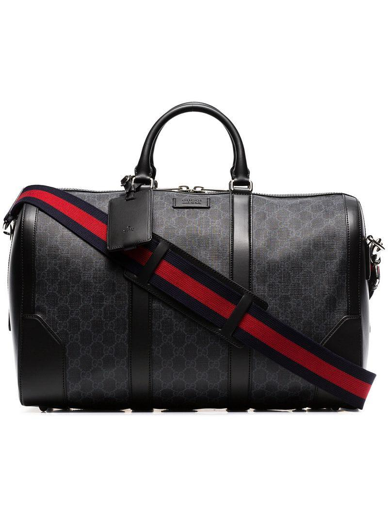 1ec71c60cb967c Lyst - Gucci Black Logo Print Leather Trim Canvas Duffle Bag in ...