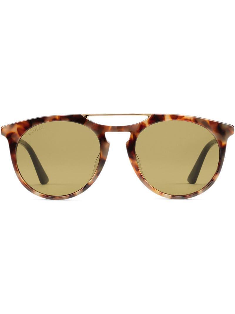 36e1832677 Gucci. Gafas de sol de acetato con montura redonda de hombre de color marrón