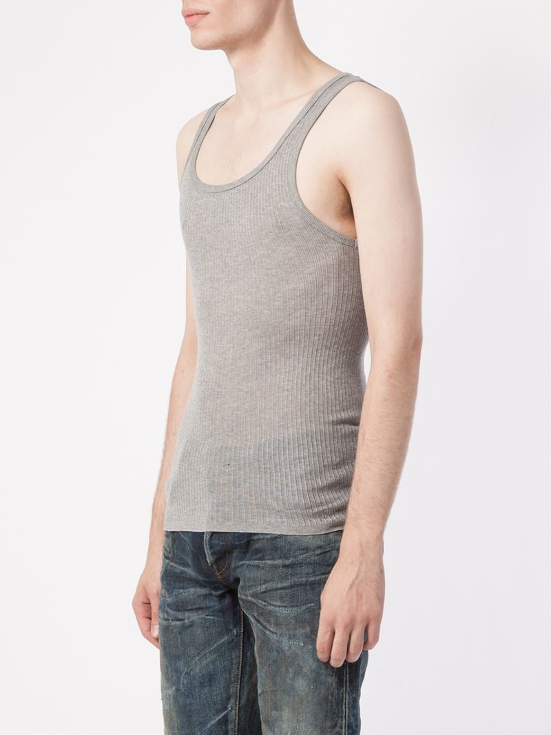 The cute and versatile Faded Glory Women's Essential Ribbed Tank Top is a must-have addition to your all-weather wardrobe. Made of a soft and stretchy cotton blend, this tank features a classic ribbed fabric construction and a tagless inner for.