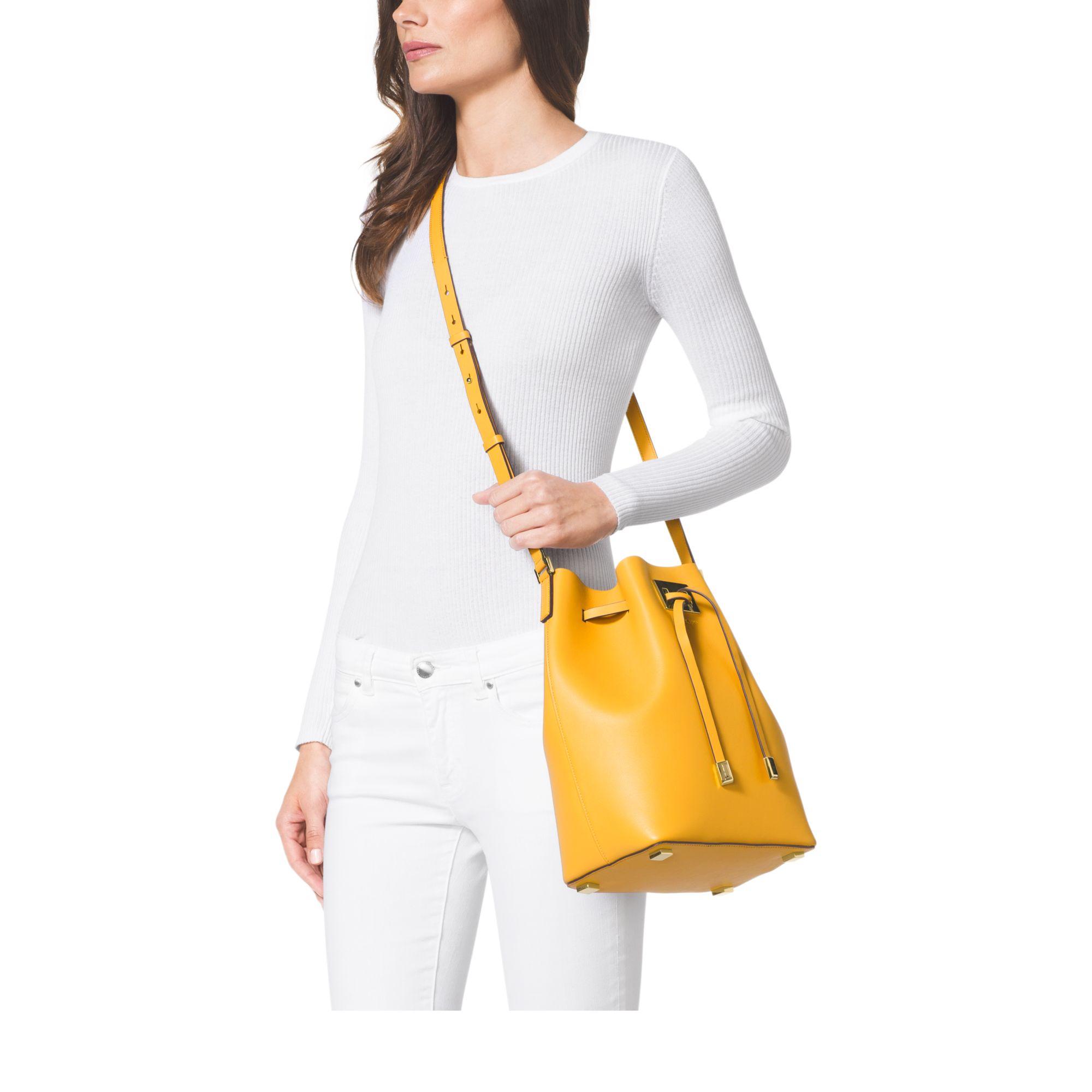 8e6b644cff27 Lyst - Michael Kors Miranda Large Leather Bucket Bag in Yellow