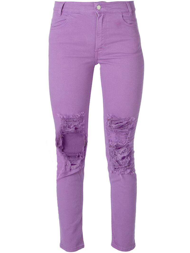 Purple ripped skinny jeans