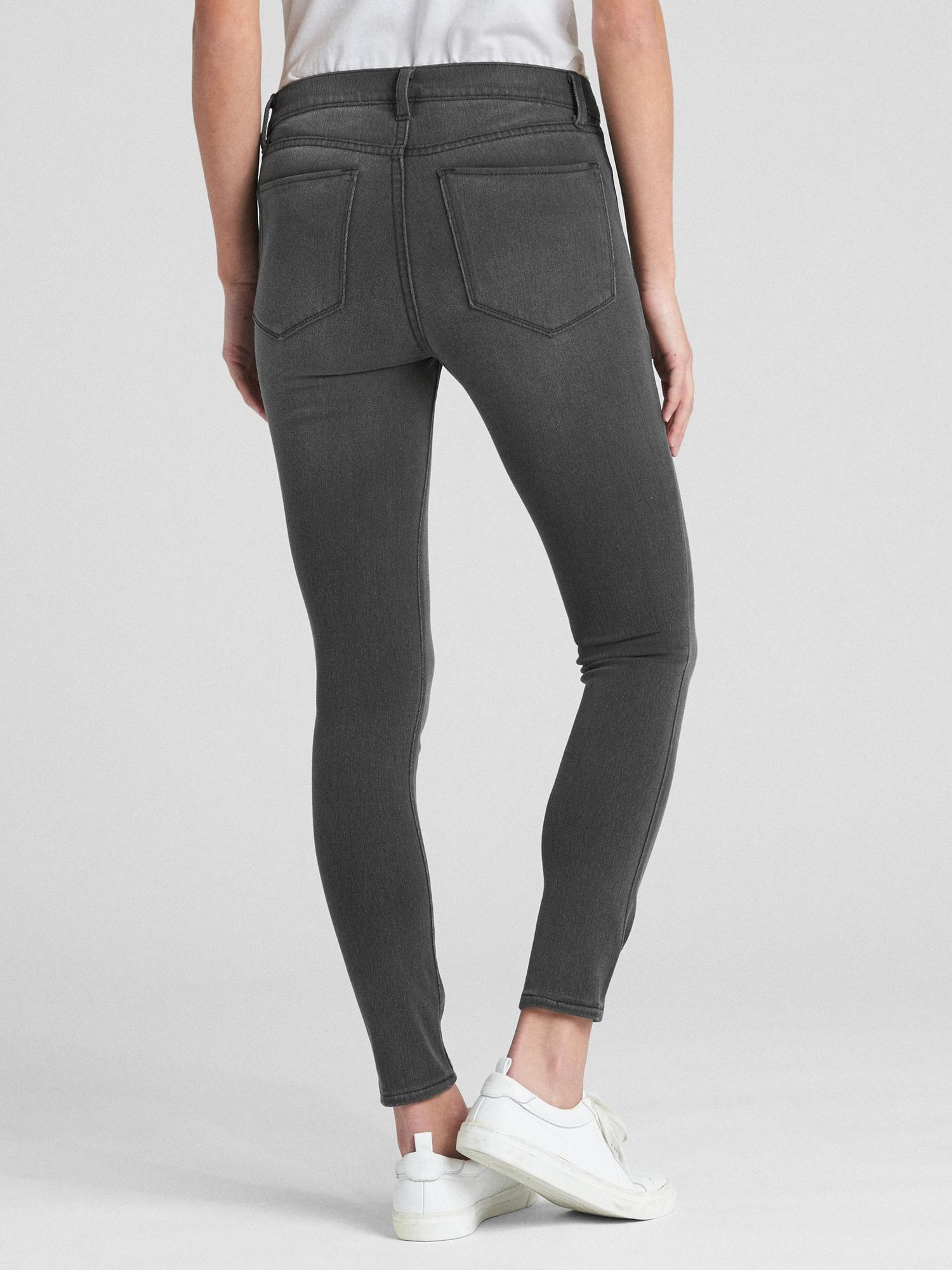 38528a94e3 Gap Soft Wear Mid Rise Knit Favorite Jeggings in Black - Lyst