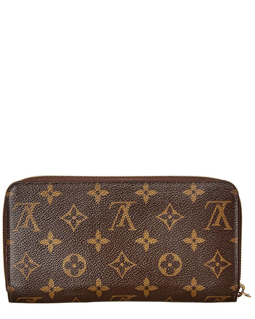 Lyst - Louis Vuitton Monogram Canvas Zippy Wallet in Brown 9317ec03d19