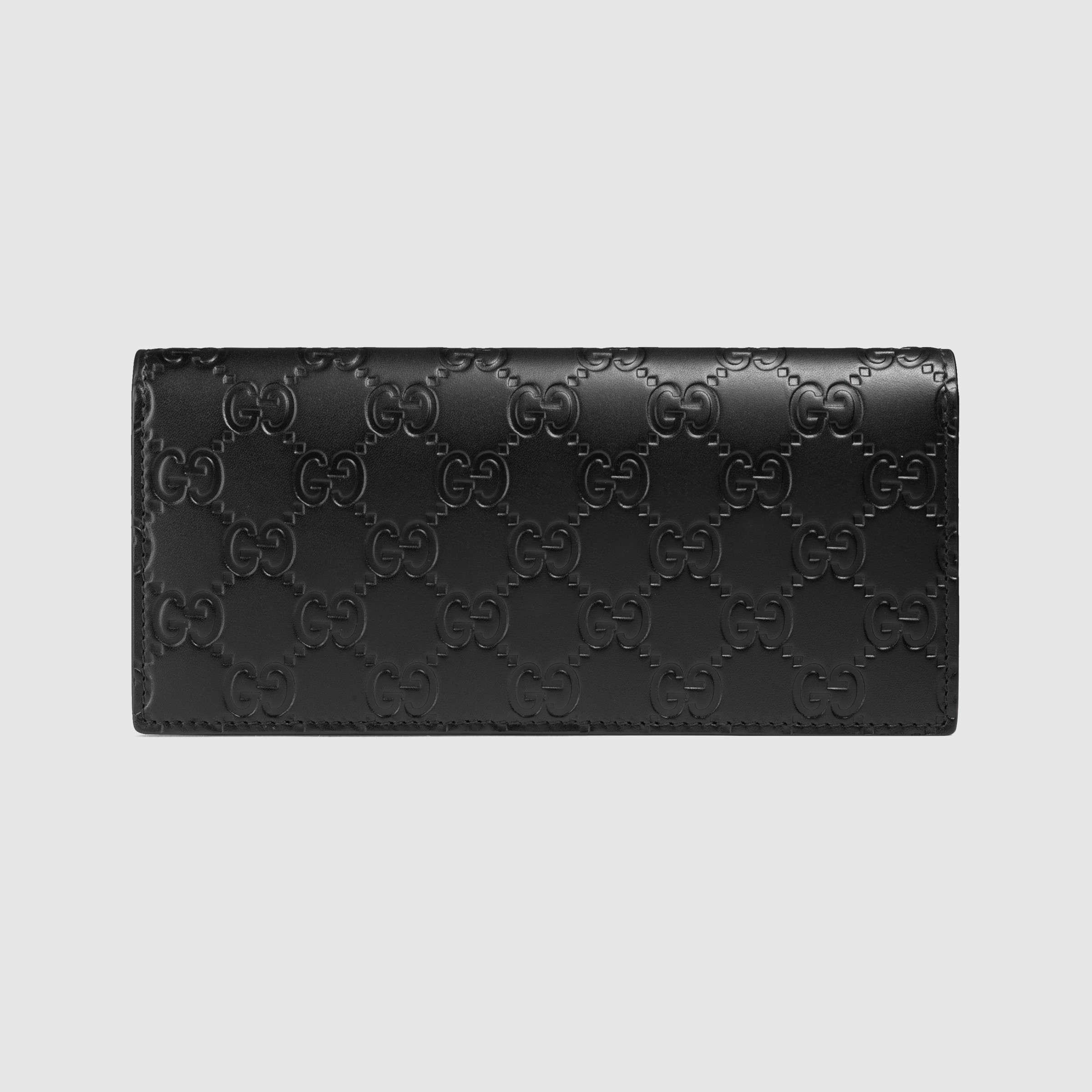 22957fc4b740 Gucci Signature Long Coin Wallet in Black for Men - Lyst