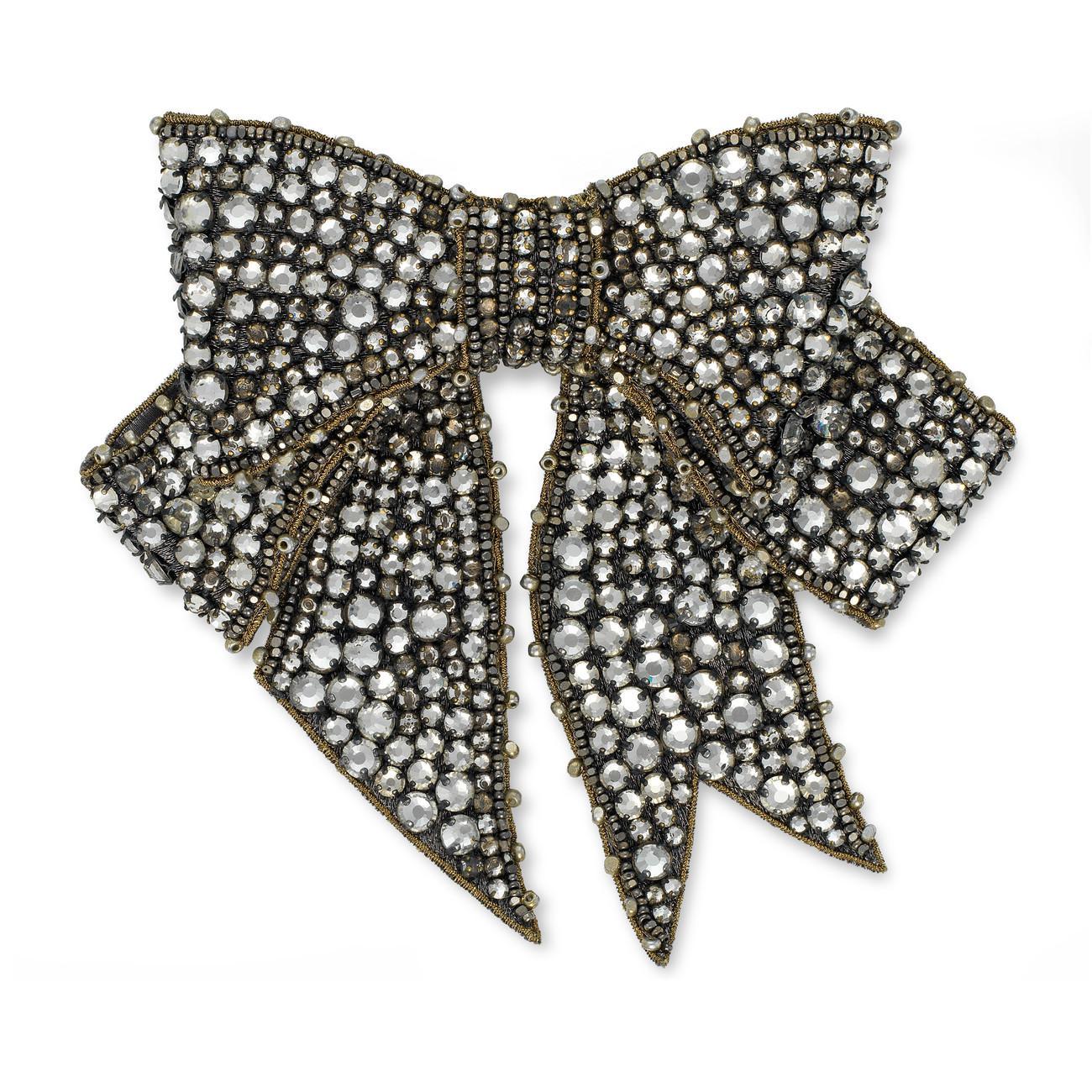 eec16b6964e Lyst - Gucci Crystal Bow Brooch in Gray