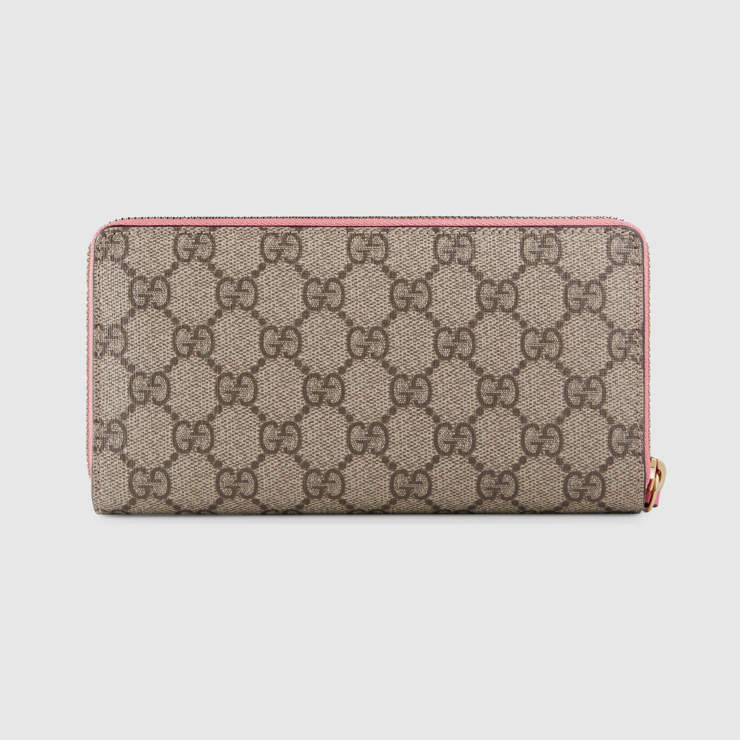 b480cffcff2 Lyst - Gucci Zip Around Wallet With Embroidered Face in Pink