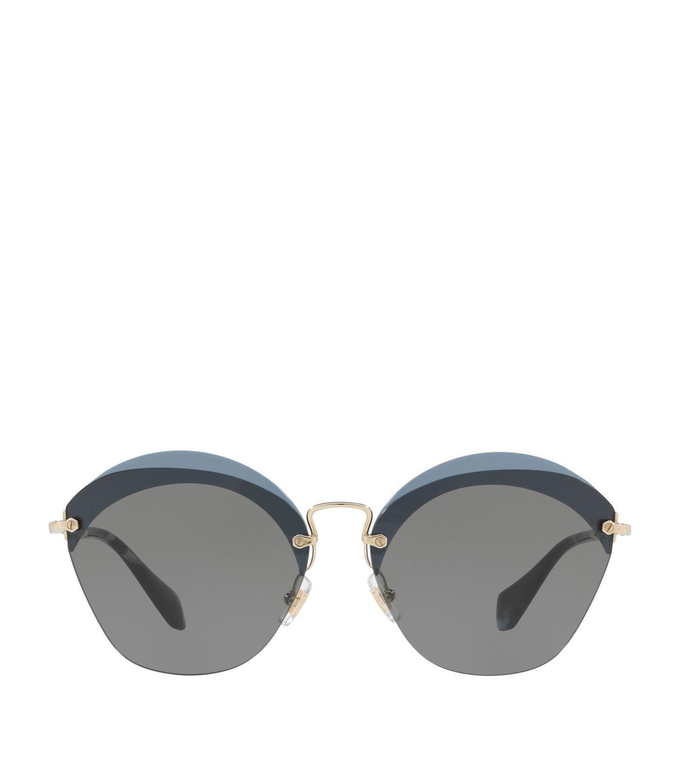 7ca4aa600cd Lyst - Miu Miu Irregular Sunglasses in Gray - Save 22%