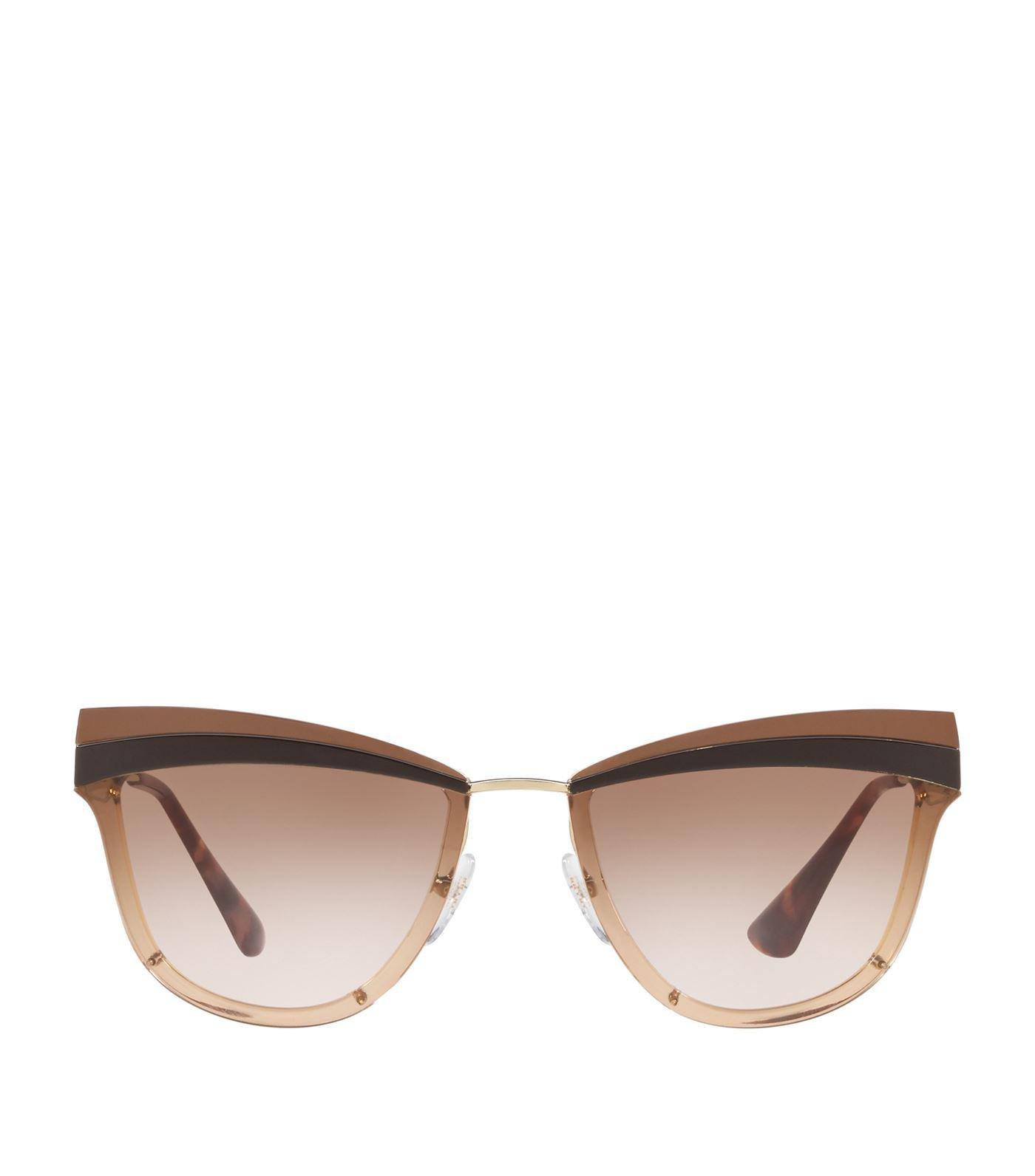 6e6a840684c4d Lyst - Prada Two-tone Cat Eye Sunglasses in Brown - Save 21%