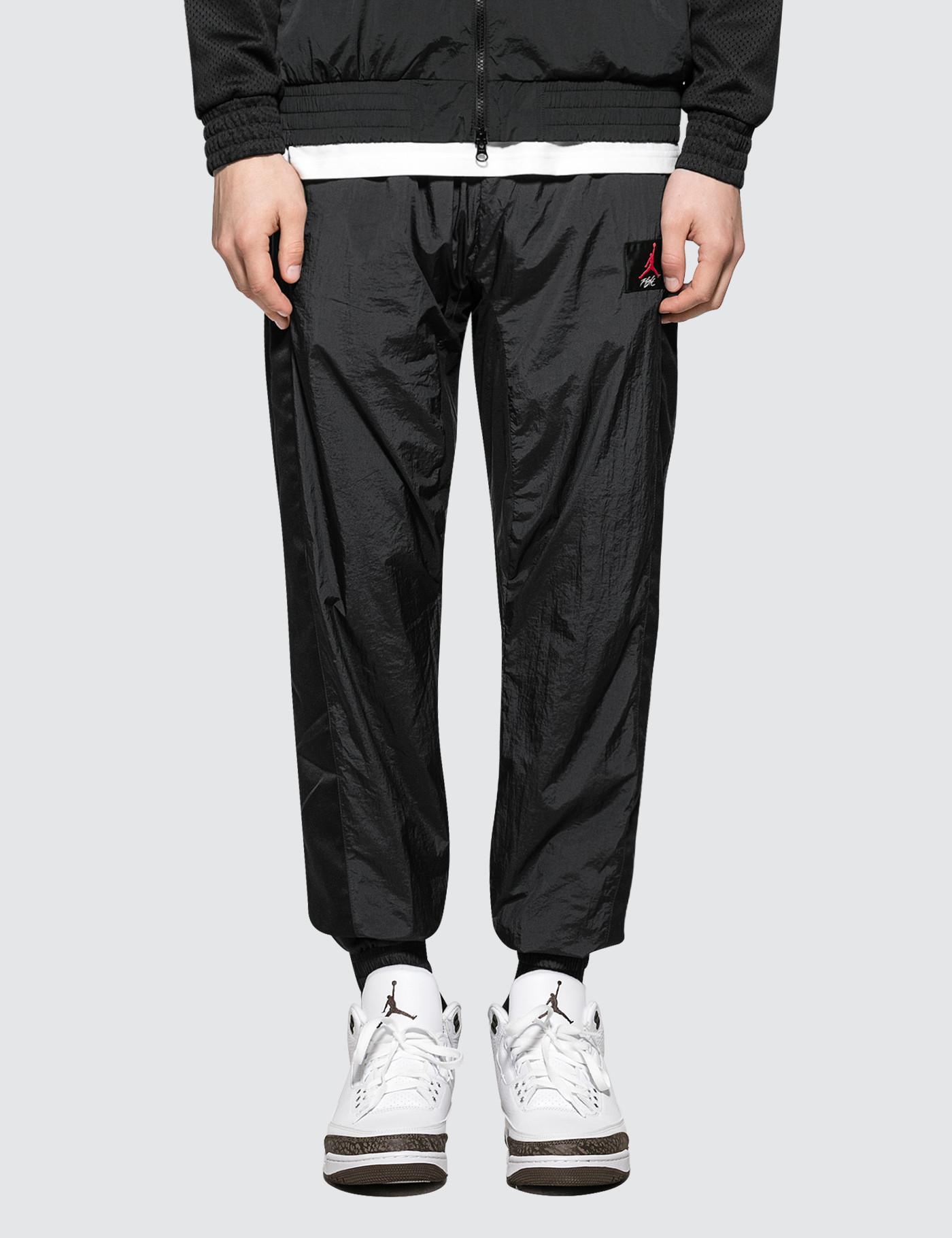 new arrival b10e2 015fc Nike. Men s Black As Flight Warm-up Pants
