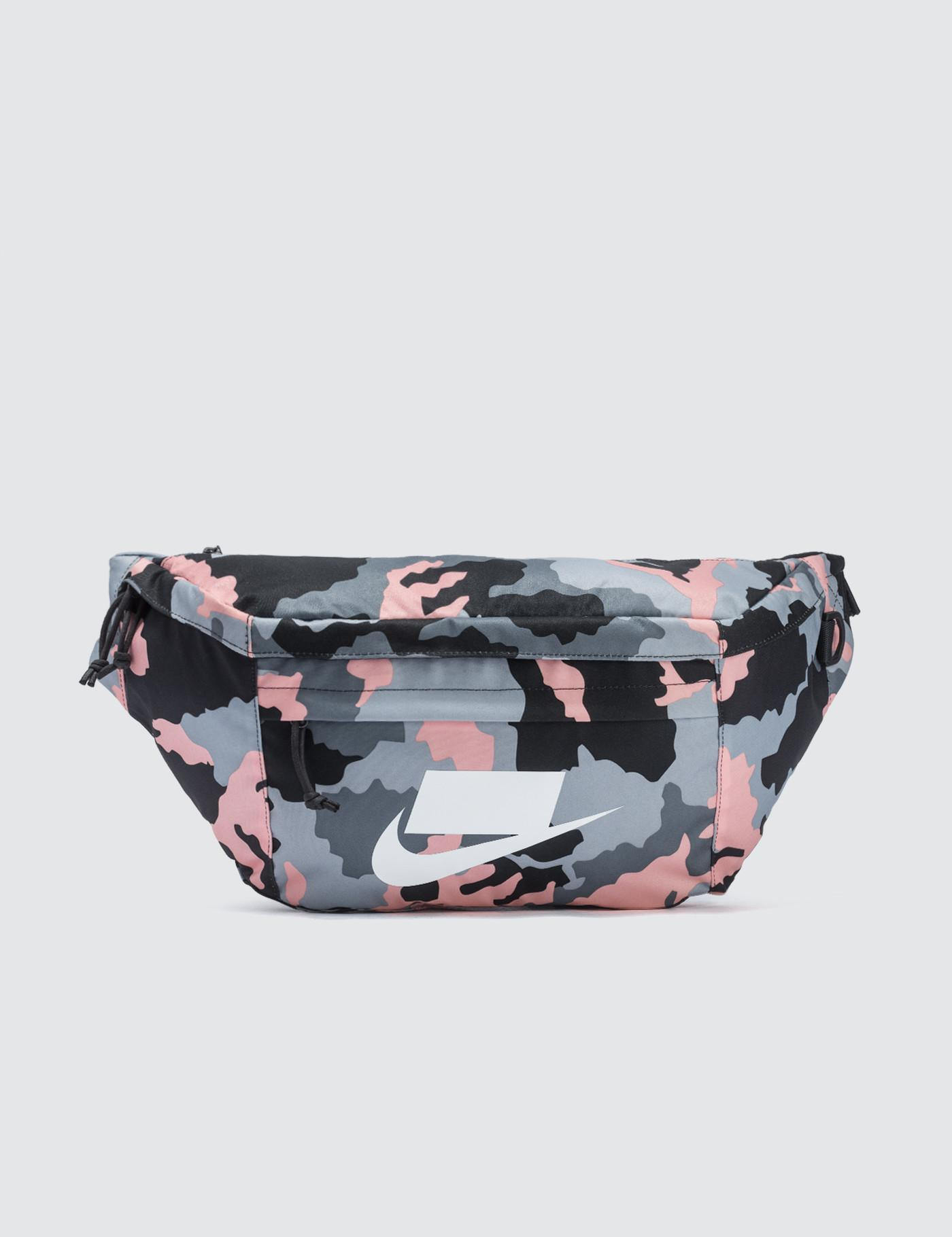 Nike Small Items Waist Pack in Pink - Lyst 7d0a4406192de