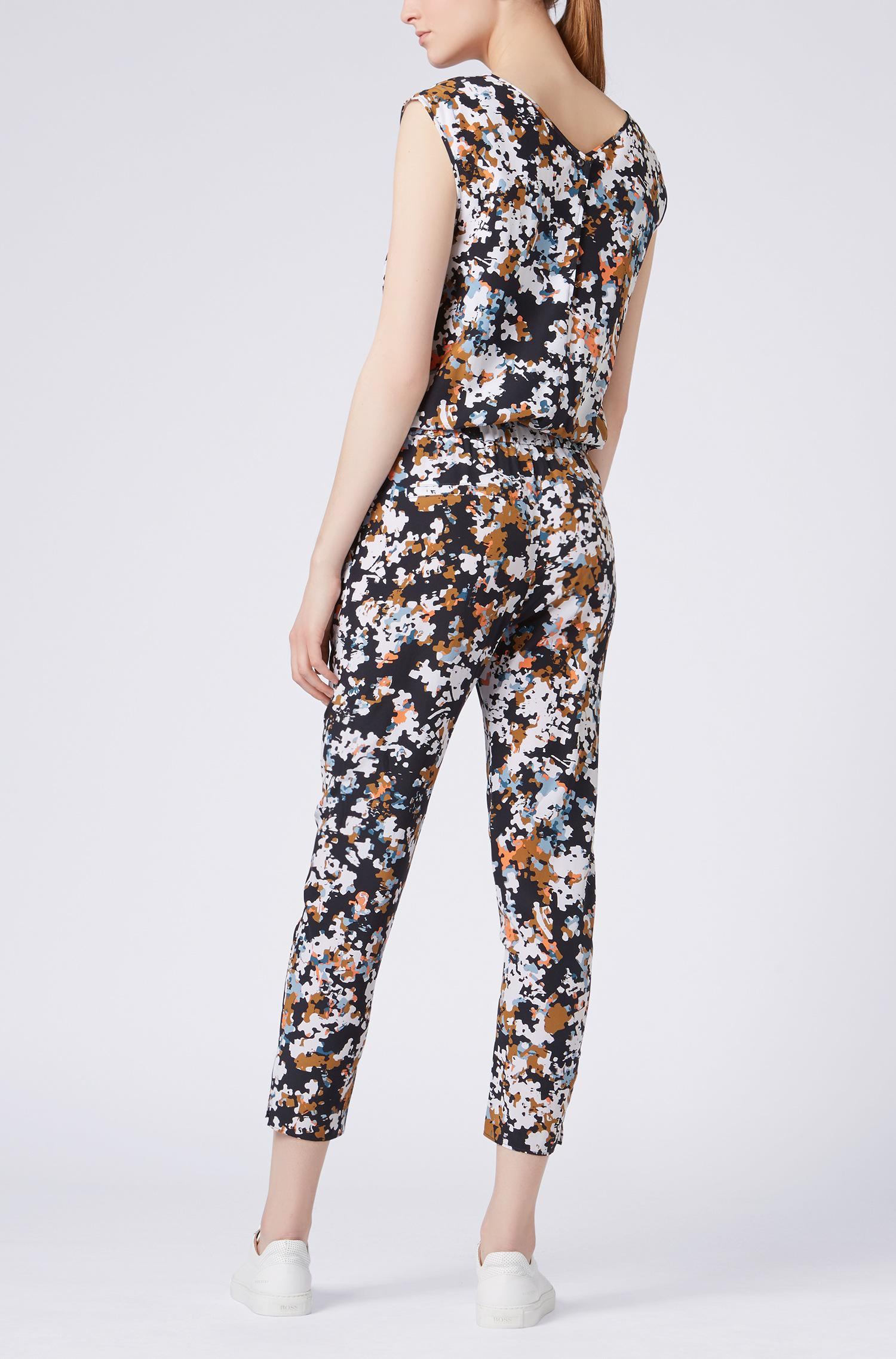 e607f2c07fb BOSS Silk Jumpsuit With All-over Puzzle Print in Black - Lyst